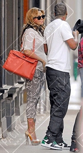 Beyonce wears a Topshop gray printed trousers.
