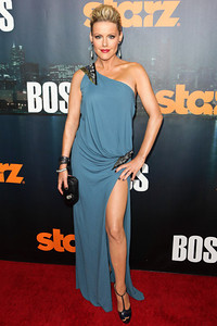 """Actress Kathleen Robertson wears a Misaki Chic bangle in gray with cultured pearls and M.C.L by Matthew Campbell Laurenza jewelry including mid pave sapphire link dangling earrings; a green pave sapphire bangle; and a navy enamel bangle with black sapphires to the premiere of the new Starz series, """"Boss,"""" at the Arclight Theatres in Hollywood on Oct. 6, 2011. Robertson carries an M.C.L by Matthew Campbell Laurenza black miniaudiere with pave sapphire beetle."""