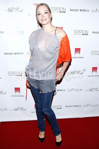 Actress Alexandra Holden wears a Candy orange and gray chiffon top and an Axis print gray tank top by Nikki Rich by WTB to the Rock Fashion fundraiser in Hollywood on Oct. 5, 2011.