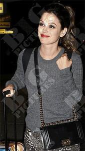 Actress Rachel Bilson wears a Topshop cable knit sweater.
