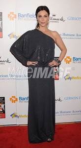 Actress Michelle Forbes wears David Meister's charcoal gray one-shoulder sequin jersey evening gown from the Fall 2011 Collection to the American Humane Assocation's Hero Dog Awards at the Beverly Hilton on Oct. 1, 2011.