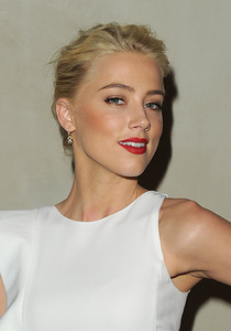 Actress Amber Heard wears Diamond in the Rough Huggie drop earrings with rough diamonds to the Giorgio Armani/Vanity Fair dinner in Los Angeles on Oct. 11, 2011.