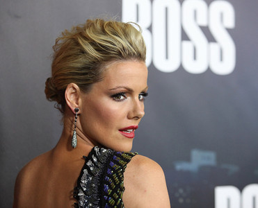 """Actress Kathleen Robertson wears M.C.L by Matthew Campbell Laurenza jewelry mid pave sapphire link dangling earrings to the premiere of the new Starz series, """"Boss,"""" at the Arclight Theatres in Hollywood on Oct. 6, 2011. Robertson carries an M.C.L by Matthew Campbell Laurenza black miniaudiere with pave sapphire beetle."""