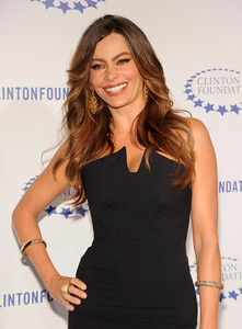 Actress Sofia Vergara wears Sutra 18K yellow gold orange sapphire and diamond earrings and a Carrera y Carrera 18K yellow gold ring with diamonds to the Clinton Foundation's Decade of Difference gala at the Hollywood Palladium on Oct. 14, 2011.