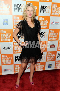 """Actress Kiera Chaplin a Dior black dress with lace detail to the premiere of """"My Week With Marilyn"""" at the New York Film Festival on Oct. 9, 2011."""