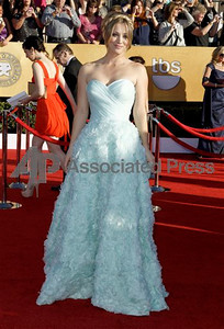 Actress Kaley Cuoco wears a tiffany blue silk strapless organza gown with a sweetheart neckline and ballgown skirt of textured voulant flowers from Romona Keveza's Spring 2012 Collection at the Screen Actors Guild Awards at the Shrine on Jan. 29, 2012.    Chris Pizzello The Associated Press