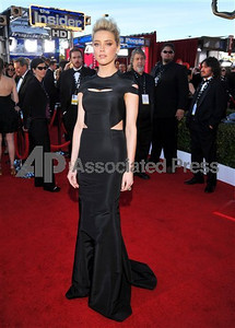 Actress Amber Heard wears a black silk faille cut-out gown by Zac Posen at the Screen Actors Guild Awards at the Shrine on Jan. 29, 2012.   Chris Pizzello The Associated Press