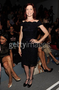 Actress Carrie Preston wears a deep violet bateau neckline cocktail dress with black lace overlay from Tadashi Shoji's Fall 2011 Collection during Fashion Week in New York on Sept. 8, 2011.