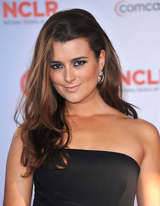Actress Cote de Pablo wears Brumani Baobab Collection 18K yellow gold with brown diamonds, aquarmarine, ruby and pink tourmaline earrings to the ALMA Awards at the Santa Monica Civic Auditorium on Sept. 10, 2011.