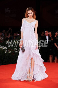 "Actress Analeigh Tipton wears a Dior light gray silk chiffon gown with embroidery to the Venice Film Festival premiere of ""Damsels in Distress"" on Sept. 10, 2011."