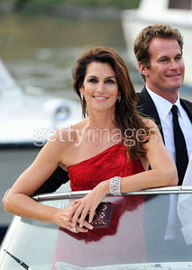 "Cindy Crawford wears heart-shaped drop diamond earrings and a diamond cuff bracelet, both by Chopard and set in white gold and a Chopard emerald-cut diamond ring set in platinum to the premiere of George Clooney's film ""Ides of March"" with her husband, Rande Gerber, at the Venice Film Festival on Aug. 31, 2011."