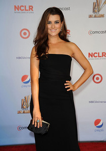 Actress Cote de Pablo wears Brumani Baobab Collection 18K yellow gold with brown diamonds, aquarmarine, ruby and pink tourmaline earrings and a Brumani Baobab Collection 18K yellow gold with brown diamonds, aquarmarine and pink tourmaline ring to the ALMA Awards at the Santa Monica Civic Auditorium on Sept. 10, 2011.