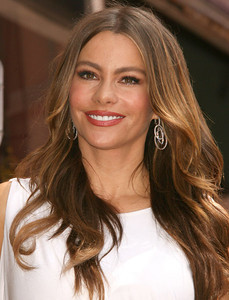 "Actress Sofia Vergara wears Adeler 18K white gold and pave diamond concentric circle earrings to the ceremony for her ""Modern Family"" co-star Ed O'Neill's Hollywood Walk of Fame star on Aug. 30, 2011."