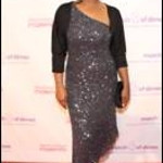 Laila Ali wears an ABS Collection sleeveless embellished dress to Fashion's Night Out in New York City on Sept. 8, 2011.