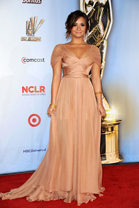 "Actress Demi Lovato wears a Maria Lucia Hohan ""Rhonda"" gown to the ALMA Awards at the Santa Monica Civic Auditorium on Sept. 10, 2011. Lovato accessorizes with an assortment of Arunashi gold bangles, an Adeler 14K yellow gold Icheko freshwater pearl ring and a Tresor Dazzle Collection morganite and diamond ring set in 18K pink gold."