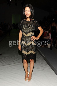 Actress Julia Jones wears a black and nude tulle cocktail dress with embroidered lace drop sleeves from Tadashi Shoji's new Spring 2012 Collection during Fashion Week in New York on Sept. 8, 2011.