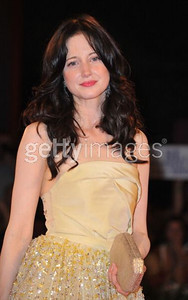 "Actress Andrea Riseborough wears Chopard chandelier earrings with diamonds to the premiere of her film ""W.E."" at the Venice Film Festival on Sept. 1, 2011."