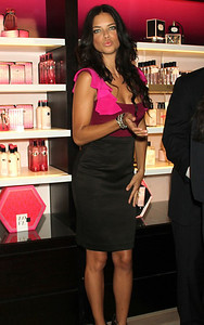 Adriana Lima wears a Rothschild fuchsia, bordeaux and black color-block ruffled sleeve dress from Jay Godfrey's Fall/Winter 2011 collection to Fashion's Night Out in New York City on Sept. 8, 2011.