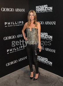 "Nicky Hilton wears black leather leggings from Alice + Olivia by Stacy Bendet and carries a black ""Lara"" Edie Parker clutch in black glitter with lucite ends at the Richard Hambleton art opening in New York on Sept. 9, 2011."