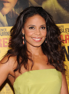 "Actress Sanaa Lathan wears Bavna 18K gold earrings with coral and diamonds to the premiere of her film ""Contagion"" at Lincoln Center in New York on Sept. 7, 2011."