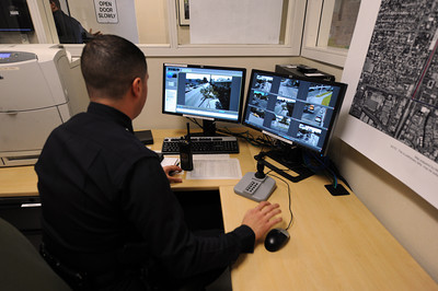 Los Angeles Police Officer Missak Diar-Beririan monitors a wireless camera system that covers areas of North Hills at the  LAPD Mission Area station Monday, April 25, 2011. (Hans Gutknecht/Staff Photographer)