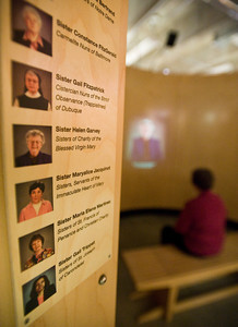 """Sister Margaret O'Rourke views a video, """"Seven Sisters Talk About Their Daily Lives,"""" in the last display areas of the exhibit. The Women & Spirit Exhibit opens on Sunday, June 19, 2011 at Mount St. Mary's College in Brentwood.  (Maya Sugarman/Staff Photographer)"""