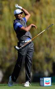 Tiger Woods drops his driver after hooking his tee shot into the trees on the 5th hole during the second round of The Chevron World Challenge at Sherwood Country Club. Thousand Oaks, CA 12/02/2011(John McCoy/Staff Photographer)