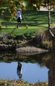Steve Strickers caddy Jimmy Johnson is reflected in the water in front of the second green on the second round of The Chevron World Challenge at Sherwood Country Club. Thousand Oaks, CA 12/02/2011(John McCoy/Staff Photographer)
