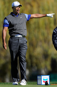 Tiger Woods shouts a warning and points to his left after he hooked his tee shot into the shrubs and trees on the 5th hole. econd round of The Chevron World Challenge at Sherwood Country Club. Thousand Oaks, CA 12/02/2011(John McCoy/Staff Photographer)