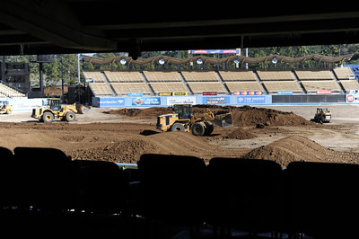 Work on the the Monster Energy Supercross Track inside Dodger Stadium in preparation for two upcoming motor sports events the Monster Energy Supercross race Saturday, January 22 followed by the Advance Auto Parts Monster Jam event on Saturday, February 19, 2011. 550 truckloads of dirt where dumped onto the field at the stadium to build the race track. (Hans Gutknecht/Staff Photographer)