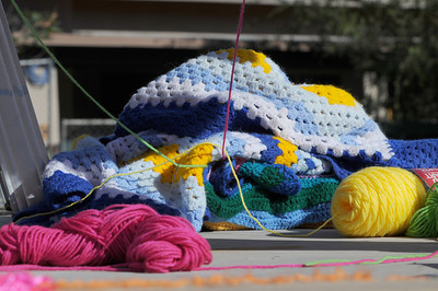 Knitters, crocheters and artists from the Los Angeles Yarn Collective are changing the face of a few landmarks at Pierce College. The group is putting a crocheted shroud over the signature Bull sculpture in the center of the school campus, as well as adding yarn to trees and other structures that lead up to the Art Quad in the upper campus. Woodland Hills , CA. 11/05/2011(John McCoy/Staff Photographer)