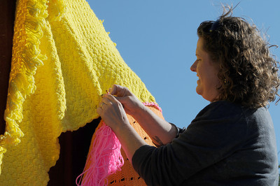 Christy Chambers works on covering the bull. Knitters, crocheters and artists from the Los Angeles Yarn Collective are changing the face of a few landmarks at Pierce College. The group is putting a crocheted shroud over the signature Bull sculpture in the center of the school campus, as well as adding yarn to trees and other structures that lead up to the Art Quad in the upper campus. Woodland Hills , CA. 11/05/2011(John McCoy/Staff Photographer)