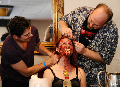 """(L) Special effects artist Steve Johnson """"Ghostbusters"""", """"Species"""" and  Emmy Award winning special effects artist Todd Masters, both work on model Mandi Moss transforming her into a zombie with just using house hold products in 30 minutes during the worldÕs first ÒAliens to ZombiesÓ Convention, a two day-long look at monsters and the post-apocalyptic world.    The event, open to the public, takes place on October 21-22, at HollywoodÕs legendary, ÒhauntedÓ Roosevelt Hotel.  A highlight of the event will be the revival of MastersÕ infamous ÒMonster-Makers BashÓ costume party, which annually attracts the industryÕs top special effects artists. Hollywood CA. Photo by Gene Blevins/LA DailyNews"""