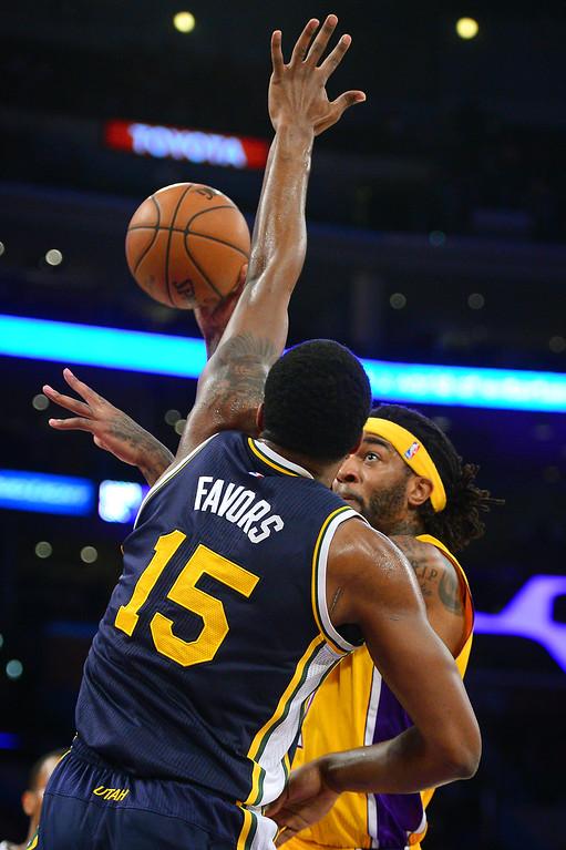 . Lakers\' Jordan Hill puts up a hookshot against the Jazz\' Derrick Favors, Thursday, March 19, 2015, at Staples Center. (Photo by Michael Owen Baker/L.A. Daily News)