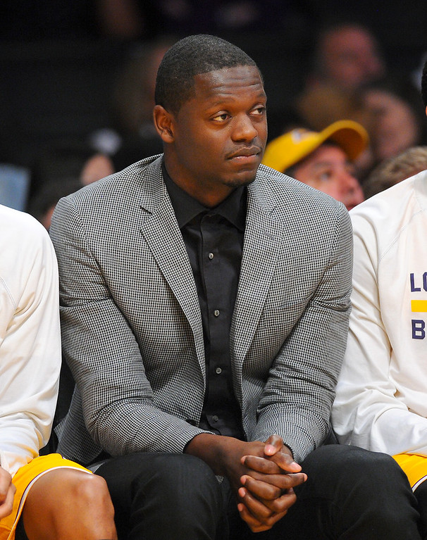 . Lakers\' injured rookie Julius Randle watches from the bench, Thursday, March 19, 2015, at Staples Center. (Photo by Michael Owen Baker/L.A. Daily News)