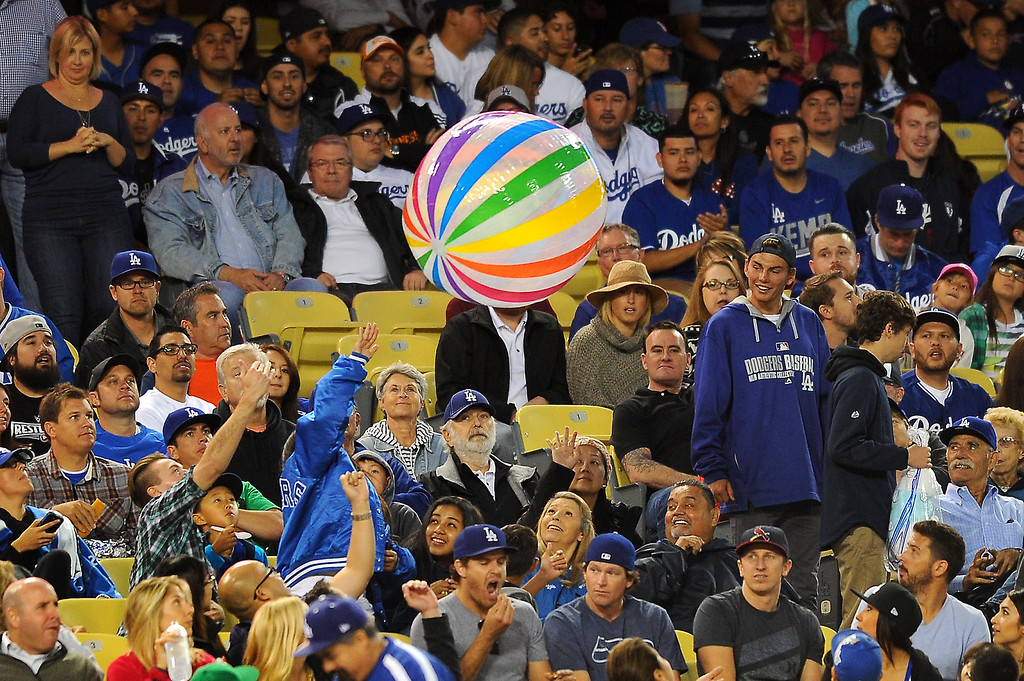 . A big beach ball is batted around the field level seats. (Photo by Michael Owen Baker/L.A. Daily News)