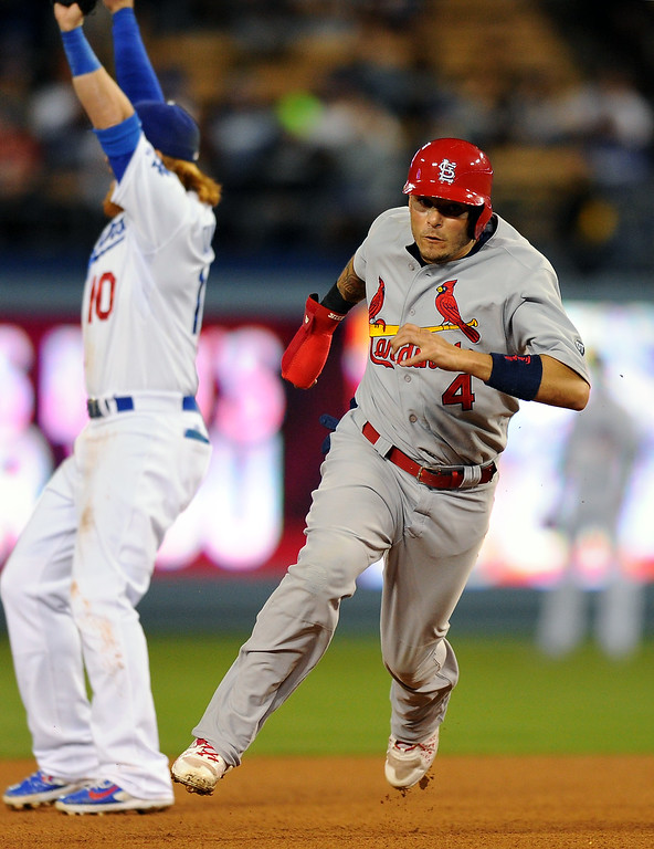 . Cardinals Yadier Molina advances to third on a double by Randal Grichuk in the eighth inning. (Photo by Michael Owen Baker/L.A. Daily News)