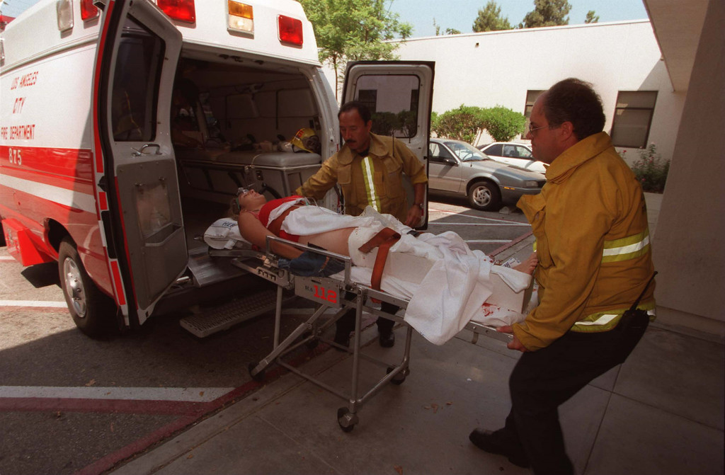 . Paramedics bring 16-year-old female victim into Holy Cross Hospital following a shooting at North Valley Jewish Community Center in Granada Hills, California, Tuesday, August 10, 1999.  She was one of five victims.  She suffered gunshot wounds to the right thigh and shin.   Los Angeles Daily News file photo.