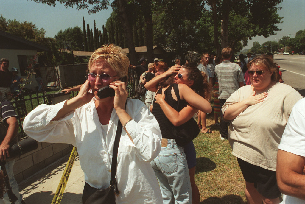 . Parents wait for information about their children who were in a daycare facility where shots were fired in the lobby. Five victims, three male children and two female adults, were shot at the North Valley Jewish Community Center in Granada Hills, California Tuesday morning, August 10, 1999. Los Angeles Daily News file photo.