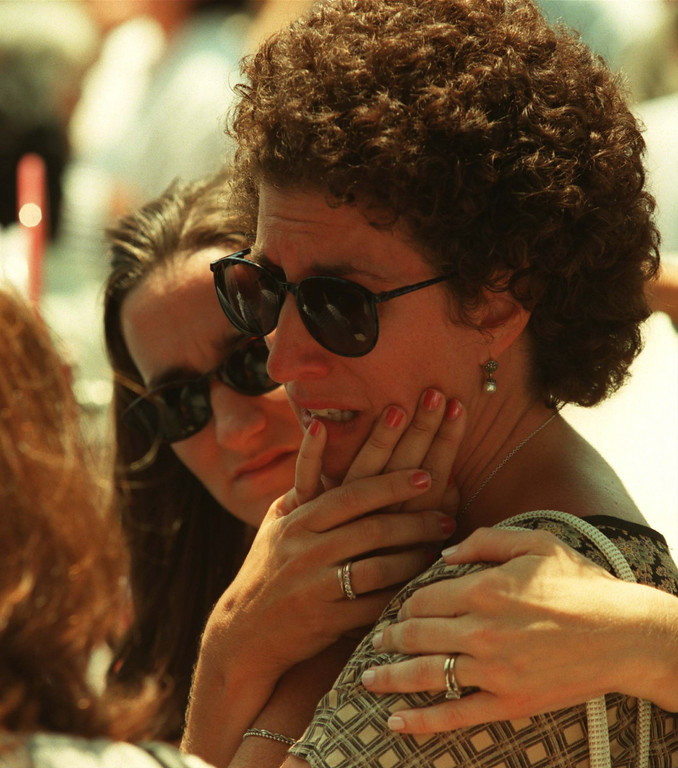 . Parents console each other at site of shooting. David Macalas, 3, speaks with media. He was inside when the shooting occurred. Five victims, three male children and two female adults, were shot at the North Valley Jewish Community Center in Granada Hills, California Tuesday morning, August 10, 1999.   Los Angeles Daily News file photo.