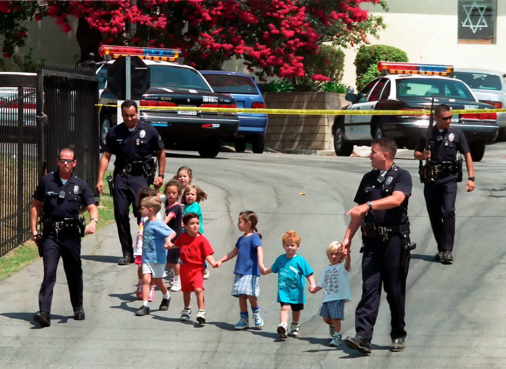 . On August 10, 1999, Los Angeles Police Officers lead children to safety after Buford O. Furrow, Jr. walked into the lobby of the North Valley Jewish Community Center in Granada Hills and opened fire with a semiautomatic weapon. The gunfire wounded five people: three children, a teenage counselor, and an office worker. After leaving the  North Valley Jewish Community Center Furrow murdered US Postal Service carrier Joseph Ileto nearby.  On January 24, 2001 Furrow pleaded guilty to avoid a possible death sentence, and was sentenced to life in prison without the possibility of parole. (Hans Gutknecht/Los Angeles Daily News)