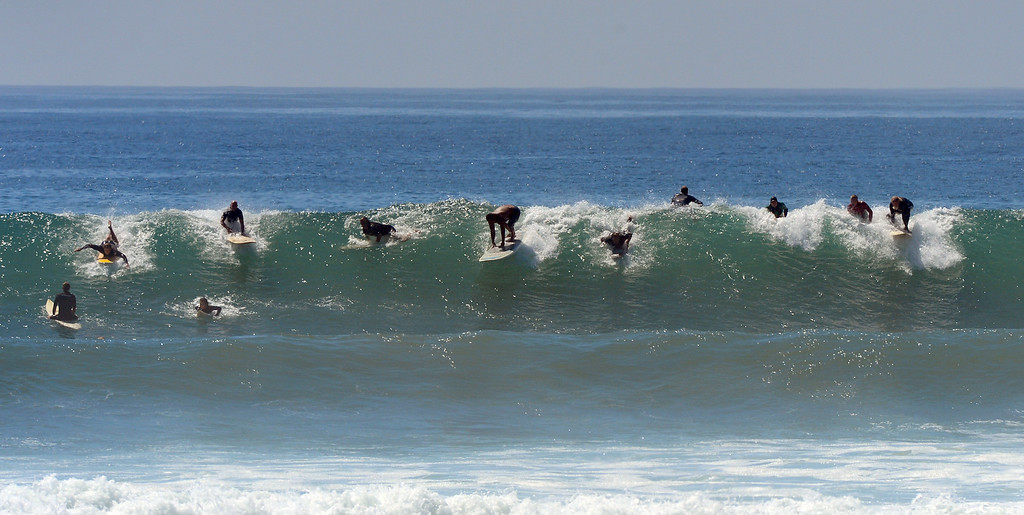. Surfers take off on a wave at Surfrider Beach in Malibu, Wednesday, August 27, 2014. (Photo by Michael Owen Baker/Los Angeles Daily News)