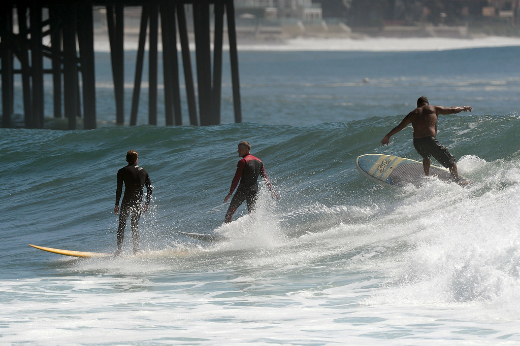 . Surfers share a wave at Surfrider Beach in Malibu, Wednesday, August 27, 2014. (Photo by Michael Owen Baker/Los Angeles Daily News)