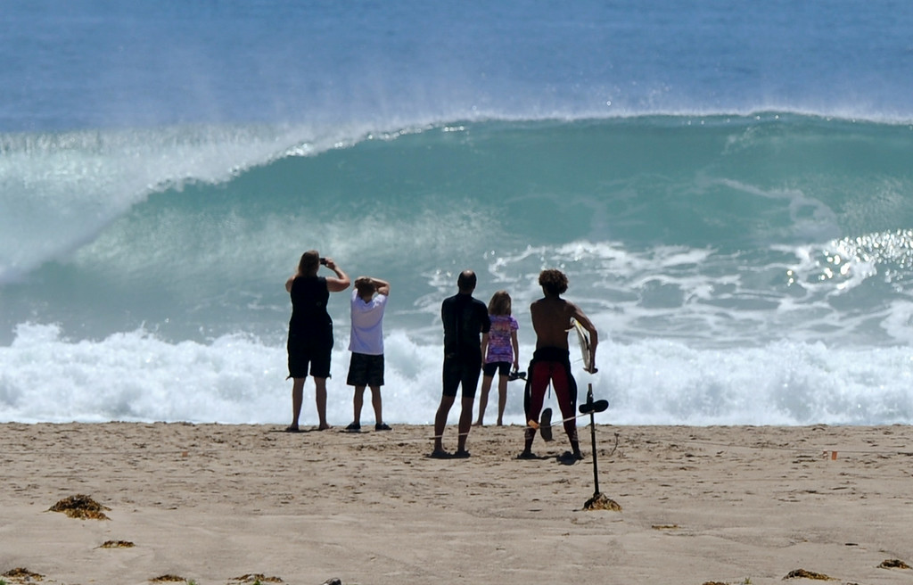 . A large set rolls in as people watch at Surfrider Beach in  Malibu, Wednesday, August 27, 2014. (Photo by Michael Owen Baker/Los Angeles Daily News)