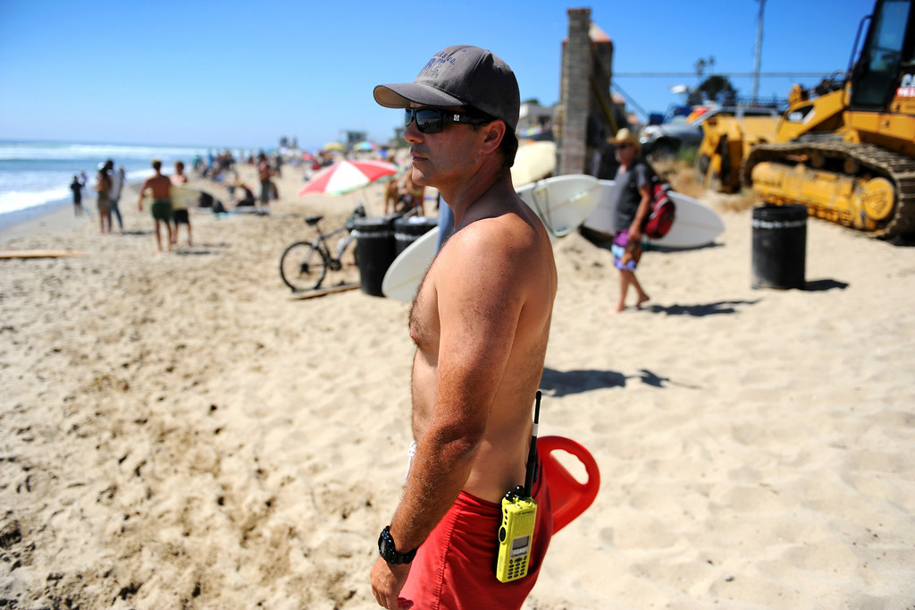 . Lifeguard Dan Murphy keeps an eye on the surfers at Surfrider Beach in Malibu, Wednesday, August 27, 2014. (Photo by Michael Owen Baker/Los Angeles Daily News)