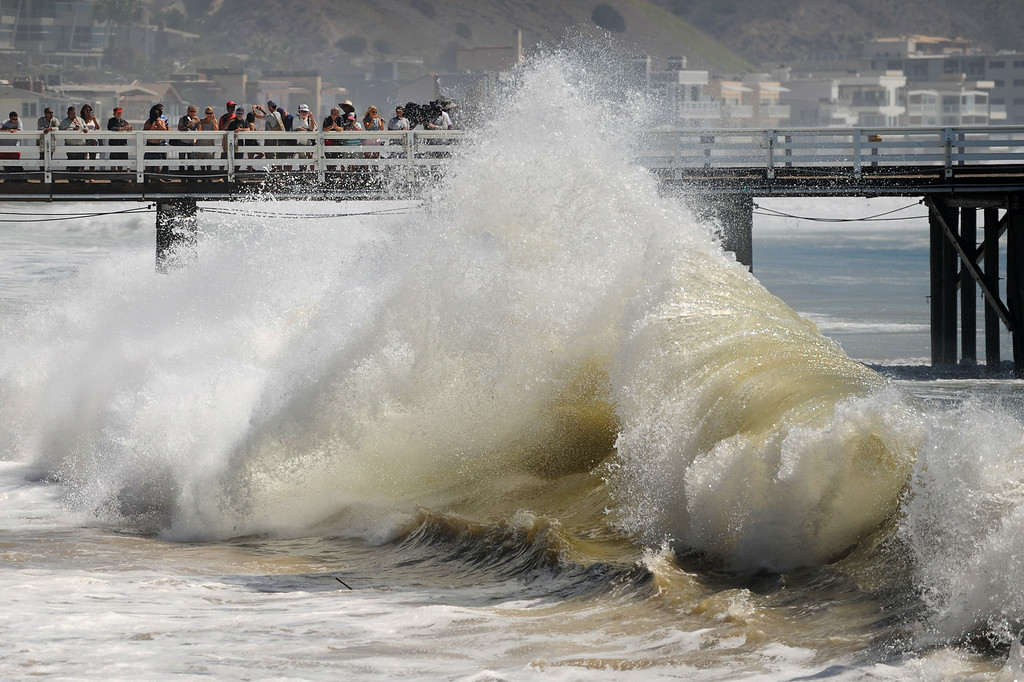 . People on the Malibu Pier watch waves pound the shore, Wednesday, August 27, 2014. (Photo by Michael Owen Baker/Los Angeles Daily News)
