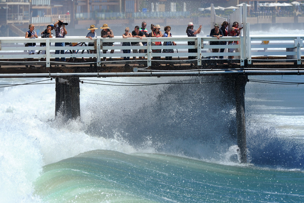 . Waves crash against pylons of the section open to the public on the Malibu Pier, Wednesday, August 27, 2014. (Photo by Michael Owen Baker/Los Angeles Daily News)