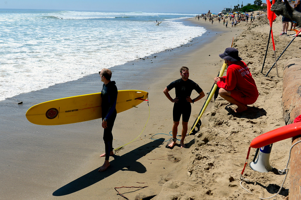. Lifeguards talk with surfers at Surfrider Beach in Malibu, Wednesday, August 27, 2014. (Photo by Michael Owen Baker/Los Angeles Daily News)