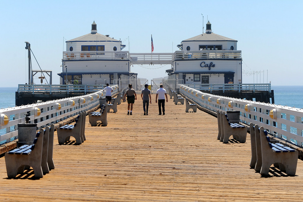 . Officials walk along the closed section of the Malibu Pier, Wednesday, August 27, 2014. (Photo by Michael Owen Baker/Los Angeles Daily News)