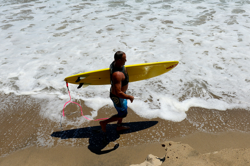 . A surfer exits the water at Surfrider Beach in Malibu, Wednesday, August 27, 2014. (Photo by Michael Owen Baker/Los Angeles Daily News)